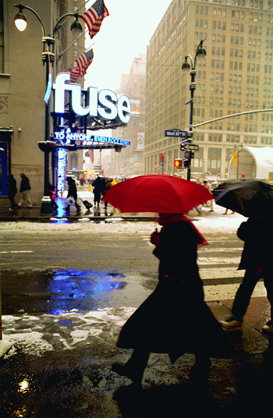 Picture of NYC street scene in front of Fuse TV building across from Madison Square Gardens.  Part of the NYC Exposed photography exhibit from www.FreePhotoCourse.com .© 2011, Michael Ginex