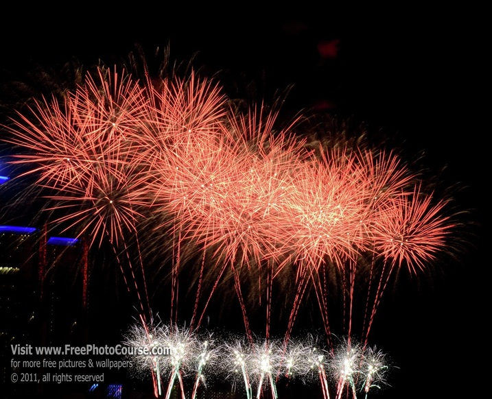 Picture of fireworks display over the Detroit River between Detroit, Michigan and Windsor, Ontario, Canada, during the annual fireworks display celebrating the freedom and friendship between the USA and Canada; © 2011, Stephen Kristof for FreePhotoCourse.com