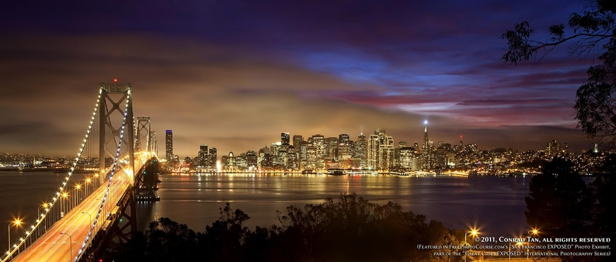 Stunning nighttime long-exposure picture of the San Francisco waterfront, shot from Yerba Buena Island (Treasure Island). Part of the online artistic photography exhibit,